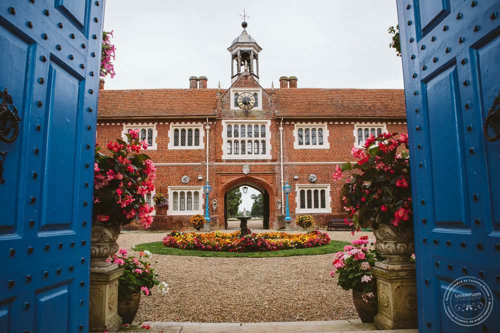 Gosfield Hall's courtyard's colourful flowerbeds in full bloom, photographed in the morning of the wedding