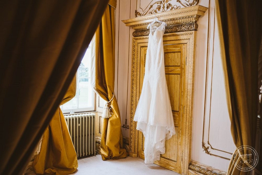 Wedding dress hanging in the Rococo suite at Gosfield Hall wedding