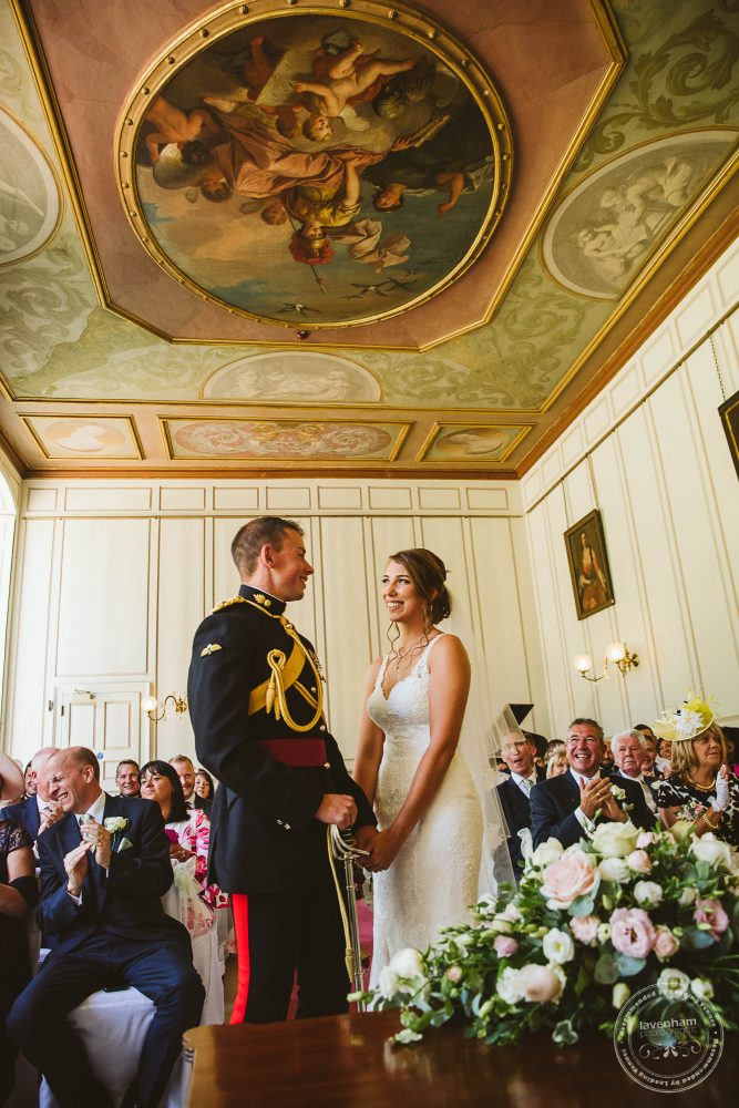 The ornate ceiling of Gosfield Hall's Grand Salon photographed during the wedding ceremony