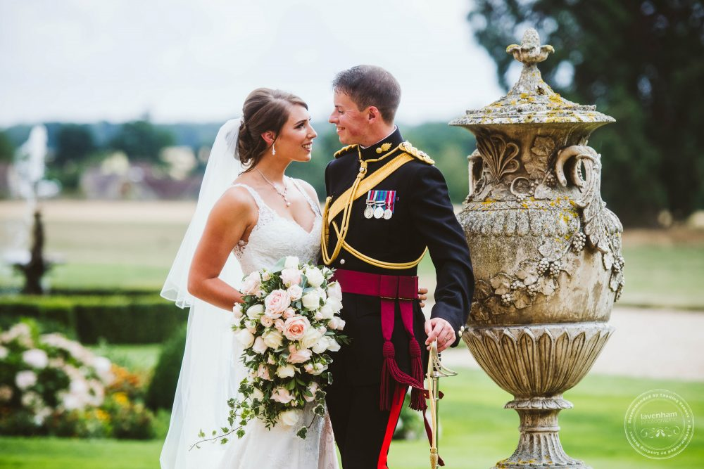 Wedding photography at Gosfield Hall with stone textures on the urn in the grounds and fountain and flowerbeds looking great in the background