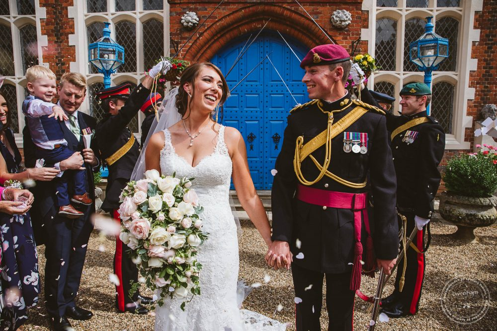 A proper military guard of honour at Gosfield Hall wedding in the courtyard after the wedding ceremony