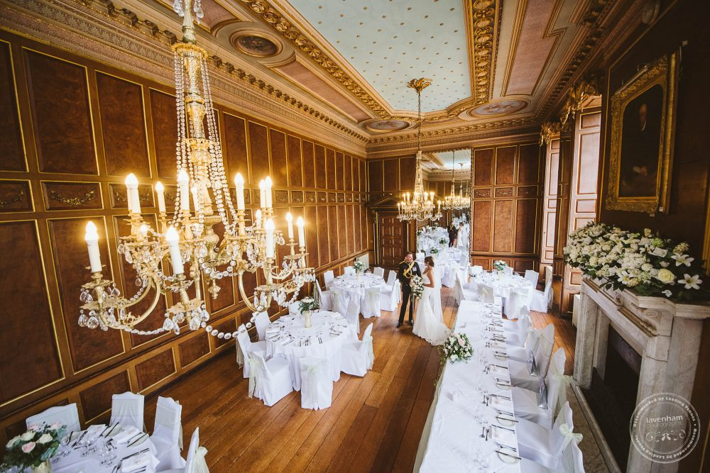 bride and groom in Gosfield Hall's amazing ballroom, set up for the wedding breakfast