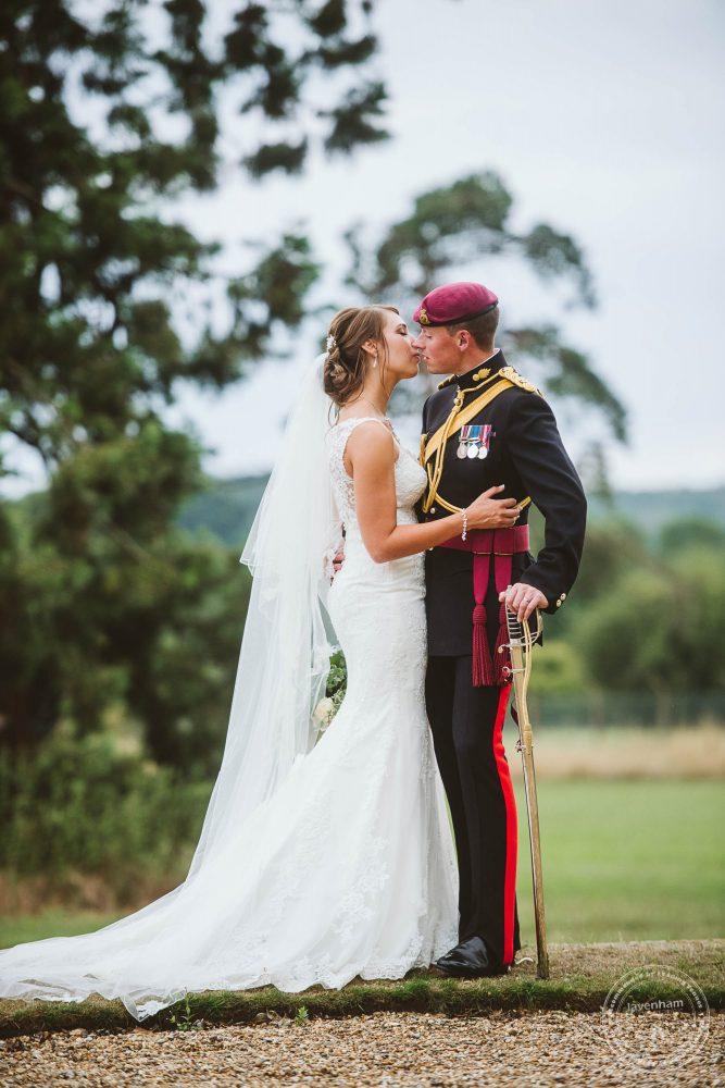 Sharing a kiss at their Gosfield Hall Wedding