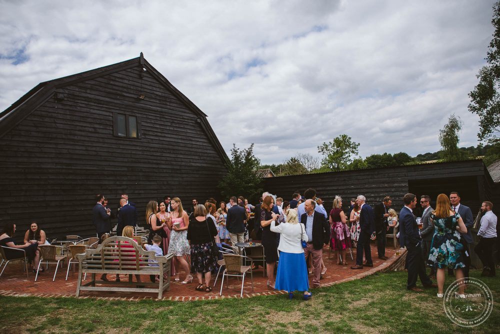 Guests mingle after the wedding ceremony at Alpheton