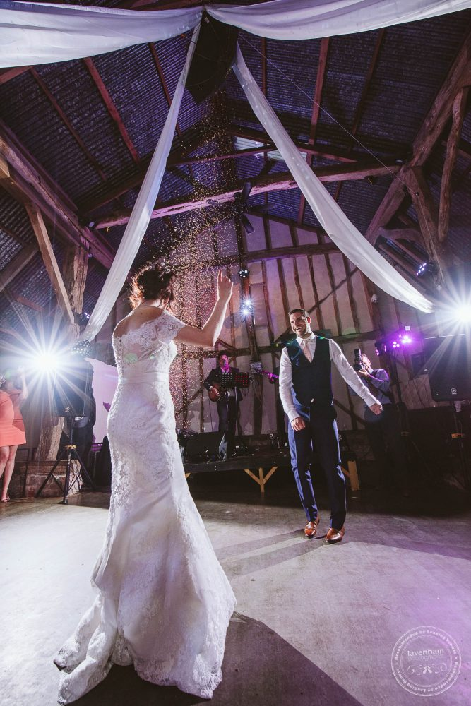 The pre-arranged confetti drop during the first dance at Alpheton Hall Barn