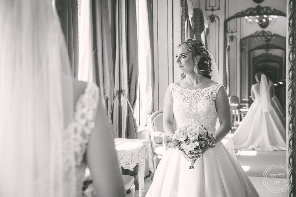 The bride in the mirror in Gosfield Hall's Rococo Suite