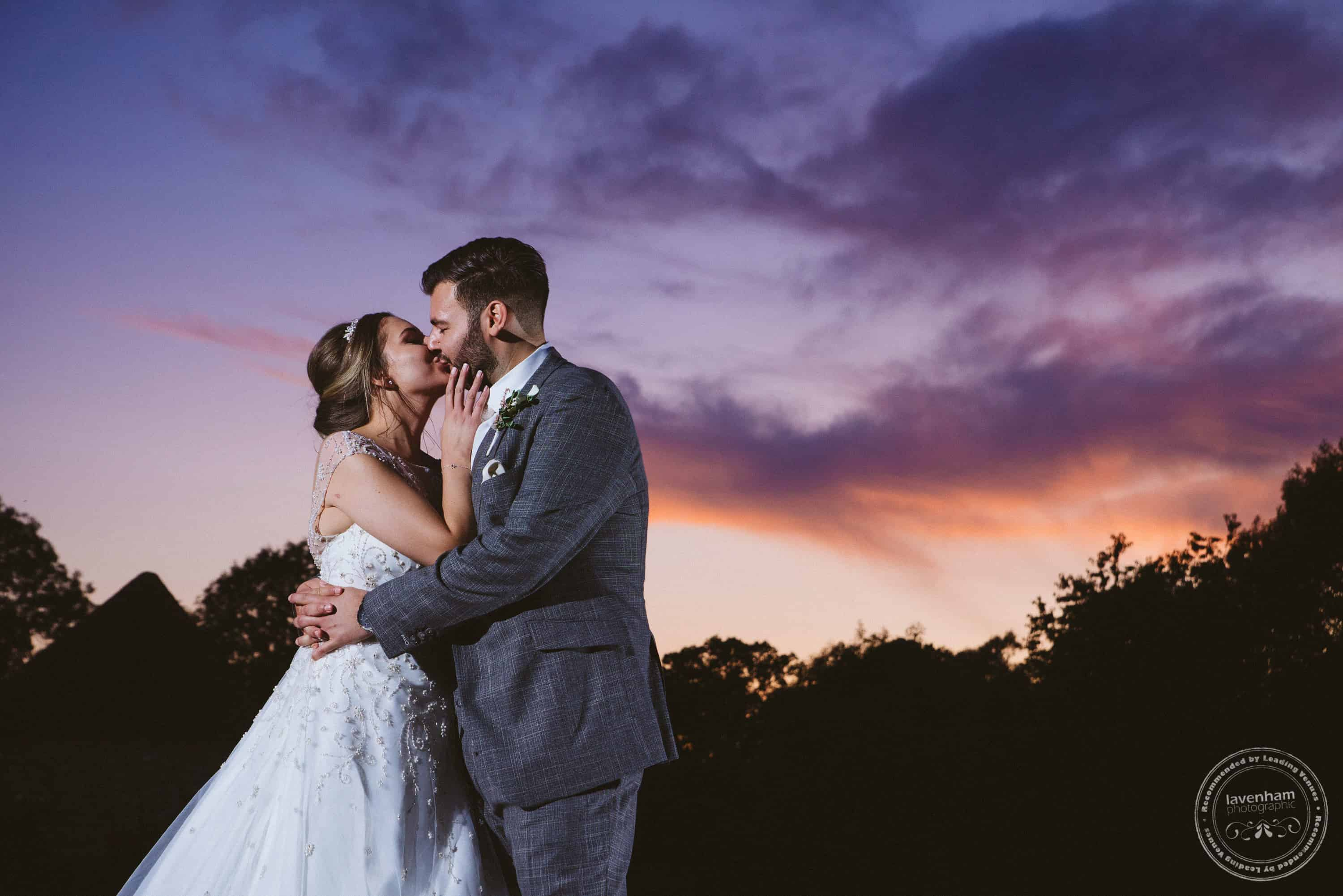 Dramatic sunset at Leez Priory, lit with off-camera flash to save the bride and groom from being silhouettes