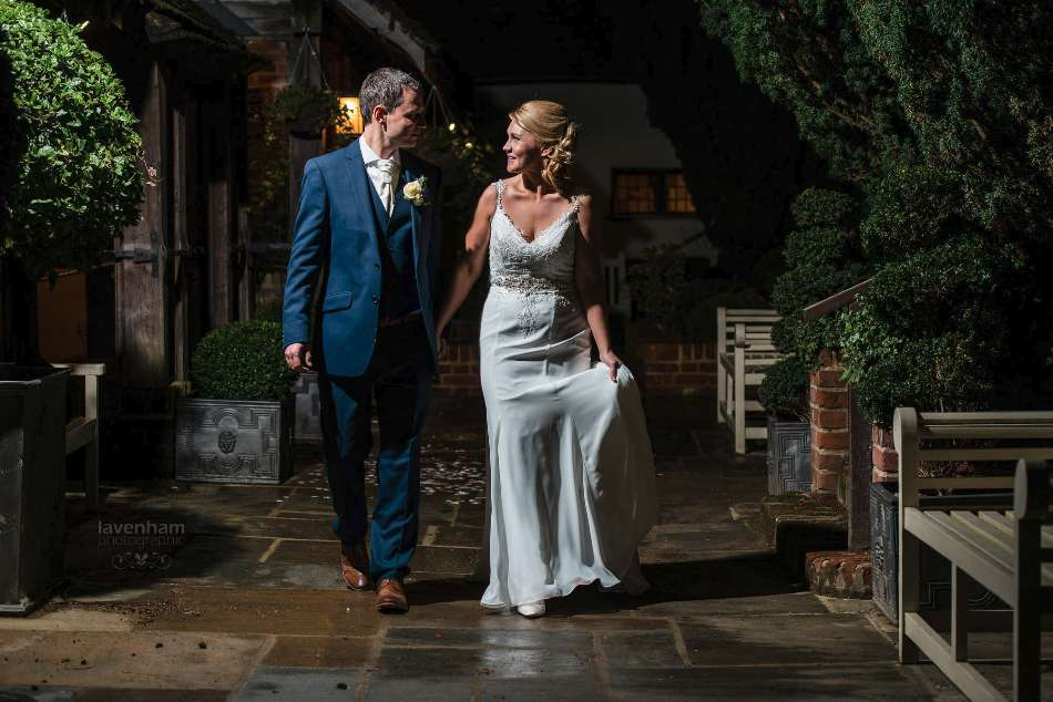 Bride and groom at Swan Hotel, walking, night photo with remote lighting