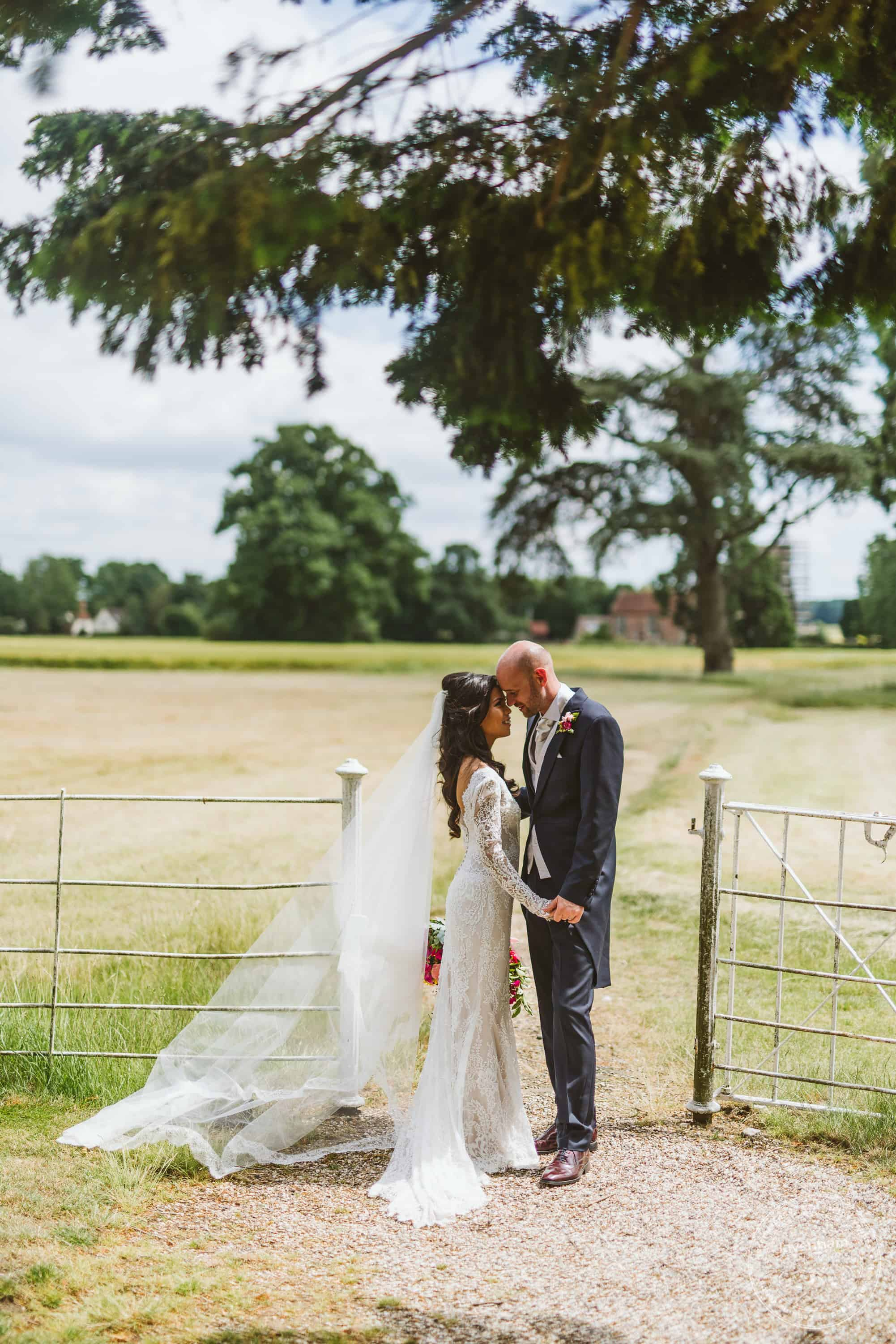 Very relaxed feeling wedding photograph at a quiet corner of the grounds at Gosfield Hall
