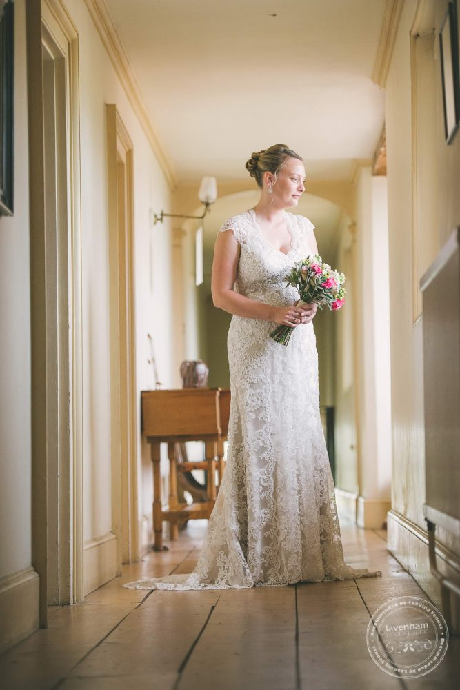 Portrait of the bride in the upper hallways and corridors at Kentwell