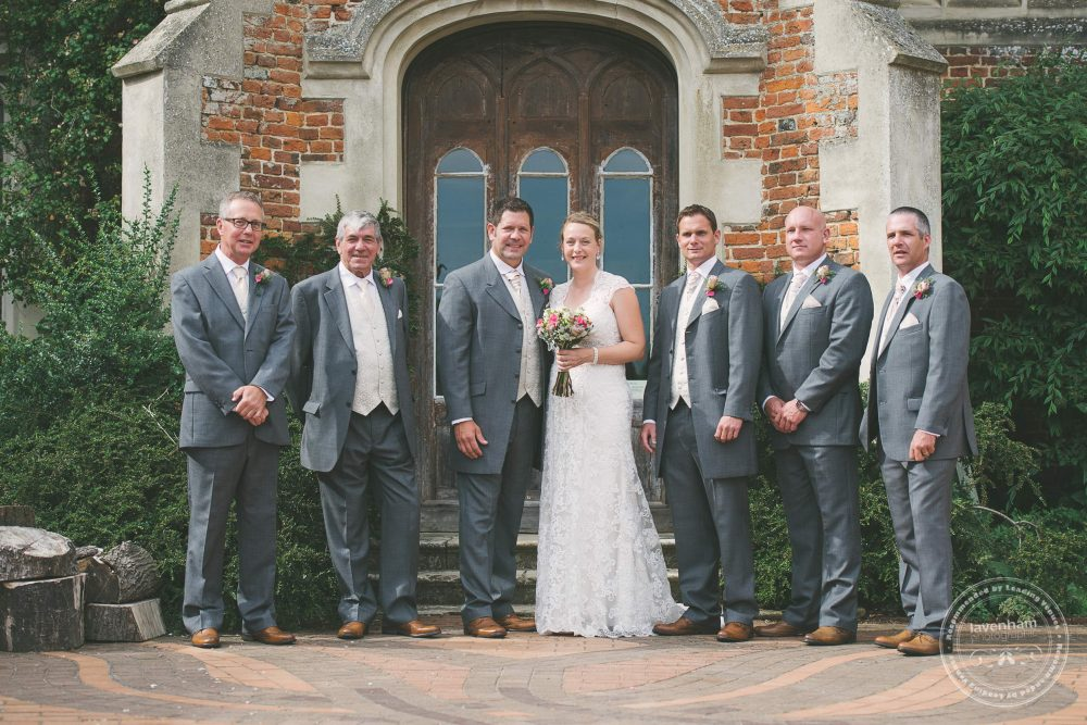 Wedding group photograph in front of Kentwell Hall