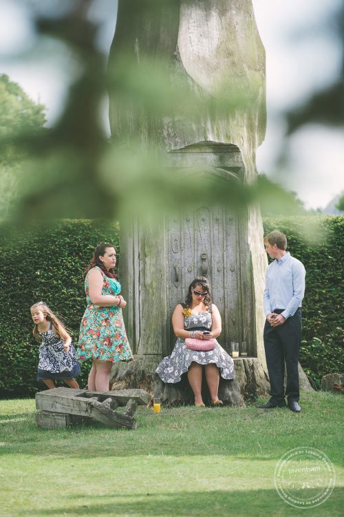 Casual photography of guests enjoying the wedding in Kentwell's grounds