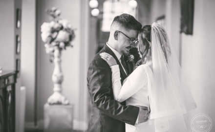 Bride and groom embrace, Gosfield Hall Wedding