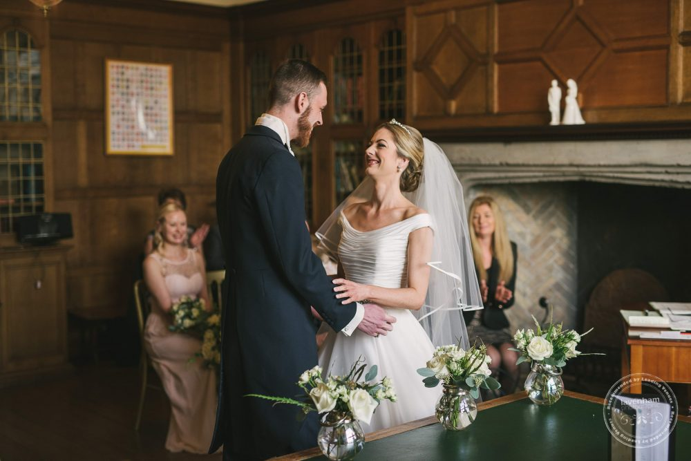 Photography of an Indoor wedding ceremony in the main house at Hengrave Hall