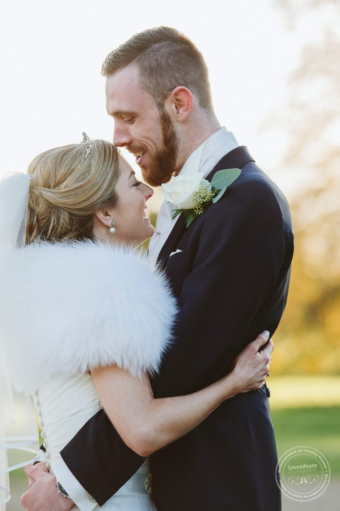 A tender moment between the bride and groom at Hengrave Hall
