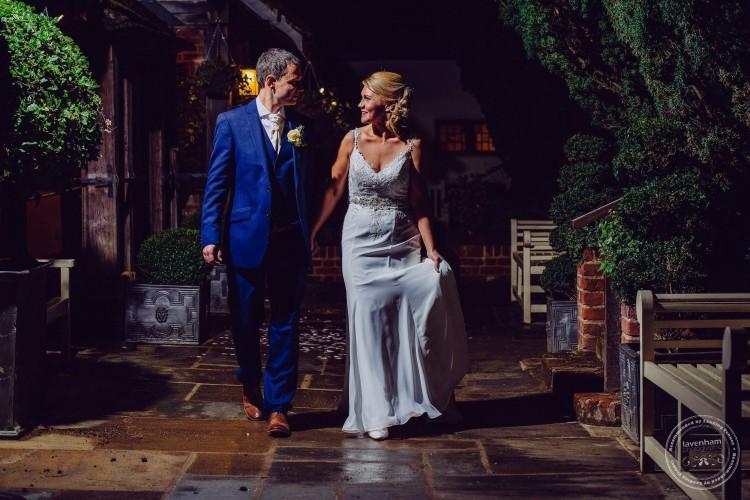 Bride & groom walk in the dark, Swan Hotel, Lavenham, Suffolk