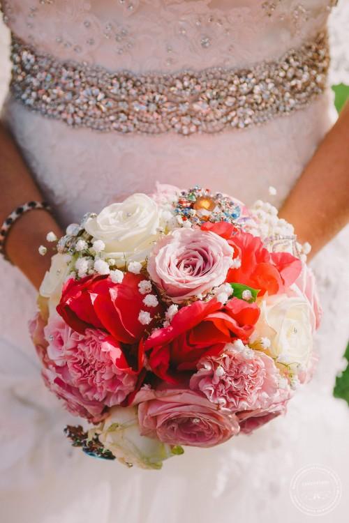 photograph of wedding bouquet with wedding dress waist band details