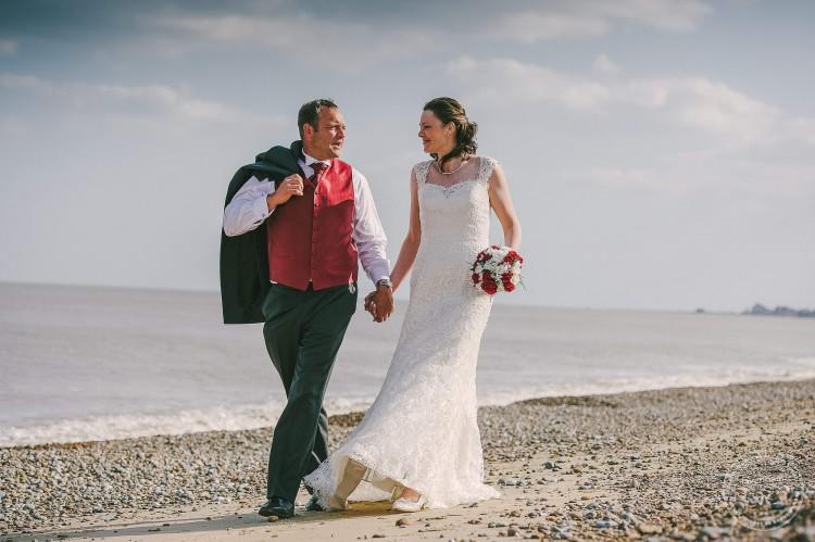 Wedding Photography, walking on Thorpeness Beach by Lavenham Photographic