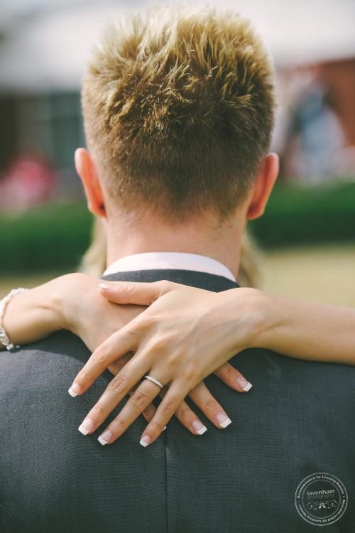 Brides hands on groom's shoulders