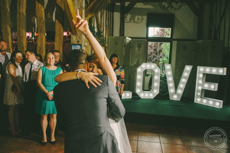Bride and groom hug during first dance, Crabbs Barn. Wedding Photography by Lavenham Photographic