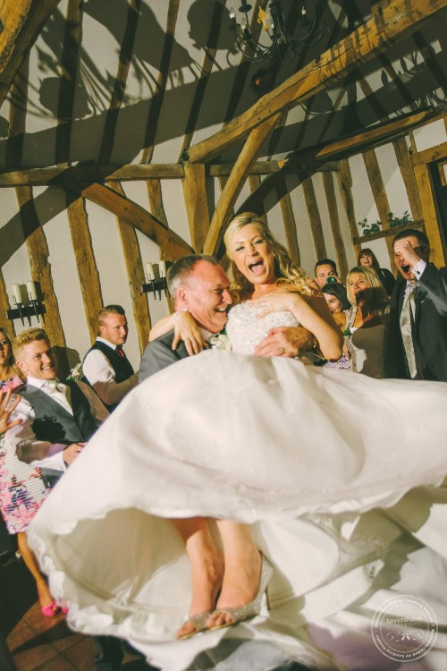 Bride's father swinging her round, Crabbs Barn. Wedding Photography by Lavenham Photographic