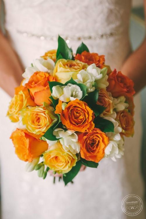 Detail of orange flowers in wedding bouquet