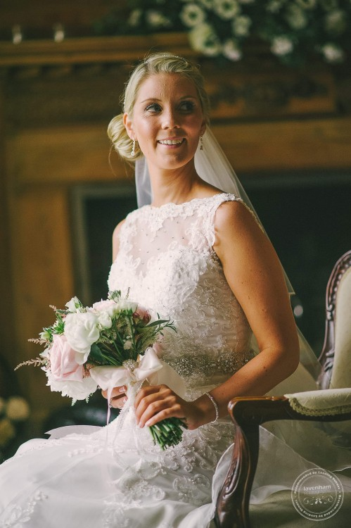 Portrait of bride sitting with natural window light, Leez Priory.