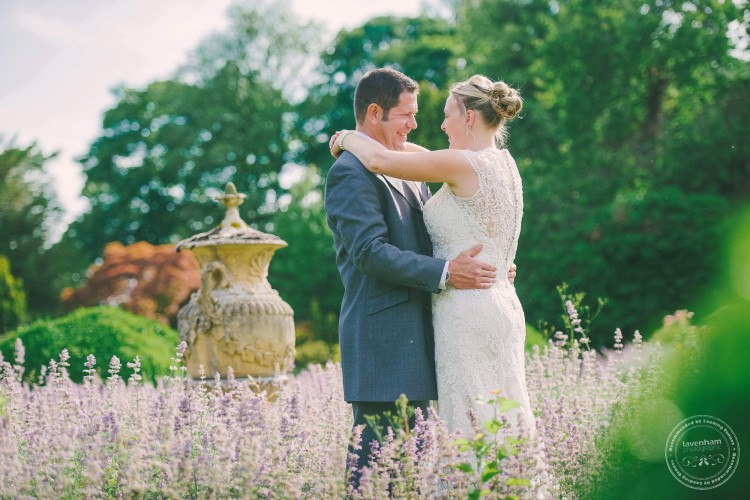 Bride & Groom at Kentwell Hall in the garden. Wedding Photography by Lavenham Photographic