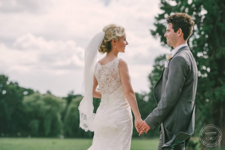 Bride & Groom photographed with field behind at Gosfield Hall