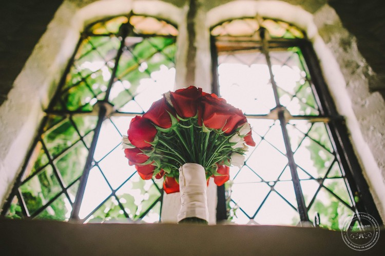 wedding bouquet photographed in old window at Leez Priory, Essex