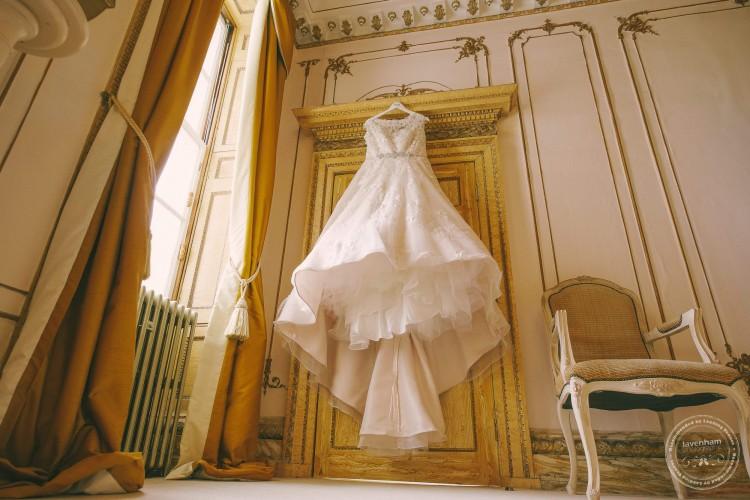 Wedding dress hanging in doorway, Gosfield Hall