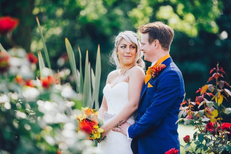 Wedding Photography, bride & groom in the rose garden, Woodhall Manor, Suffolk