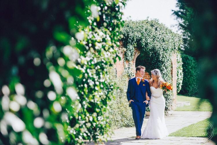 Wedding Photography, bride & groom walking, Woodhall Manor, Suffolk