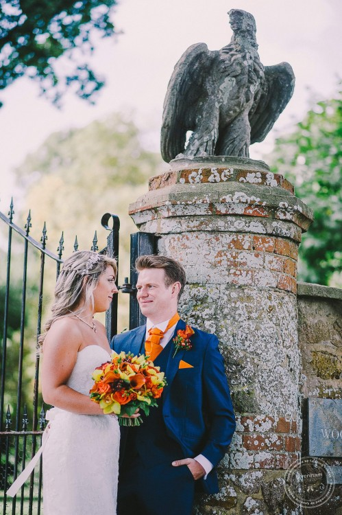 Wedding Photography at gateway with statue of eagle, Woodhall Manor, Suffolk