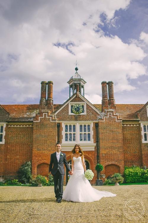 Wedding Photography at Gosfield Hall, bride & groom walking