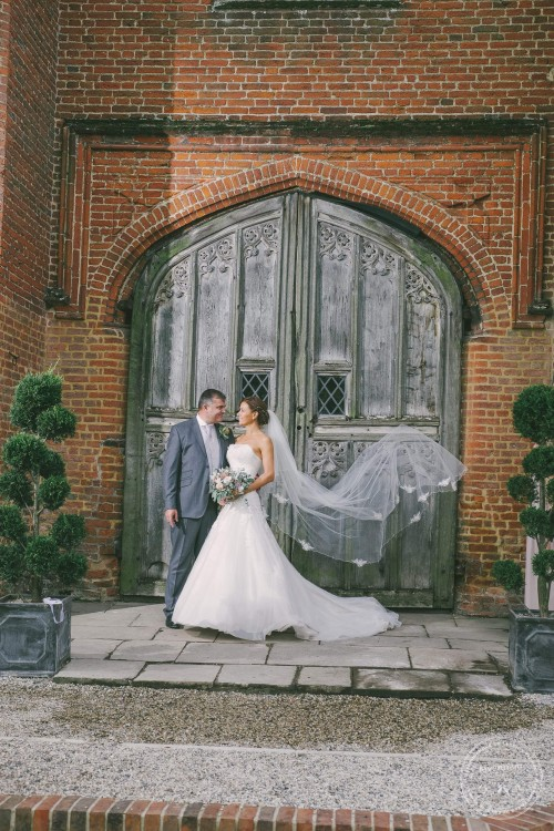 Wedding photograph with ast old doorway at the carriageway at Leez priory