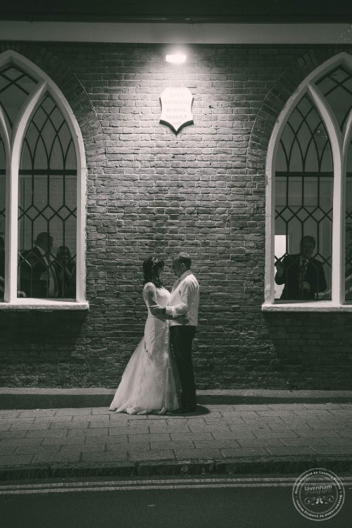 Night time wedding photography, black and white, bride and groom under street light