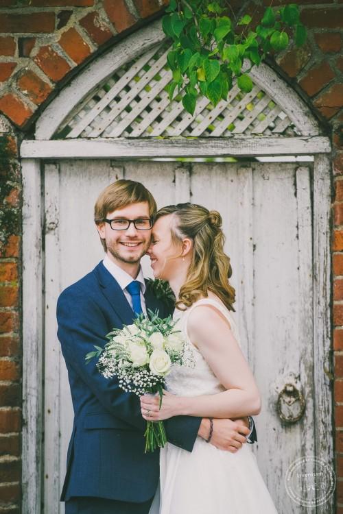 Wedding photography at old wooden gate, Lavenham, Suffolk