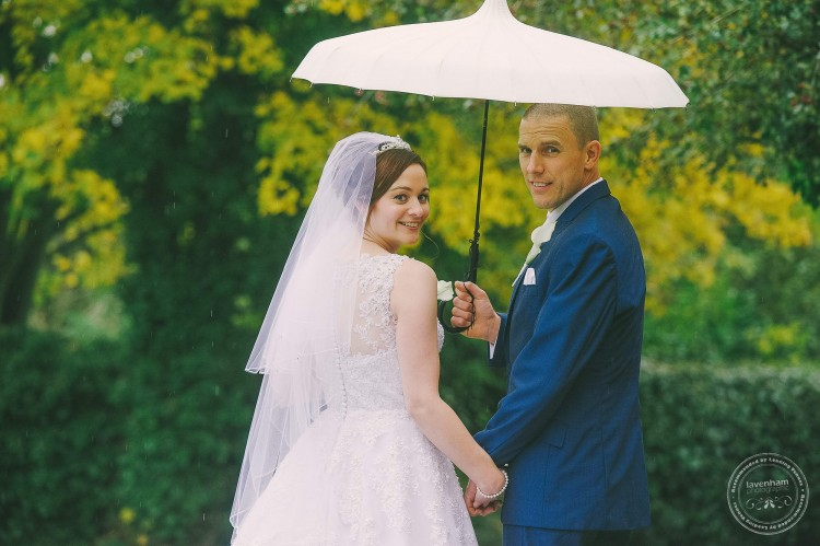 Bride and groom, wedding photography with umbrella