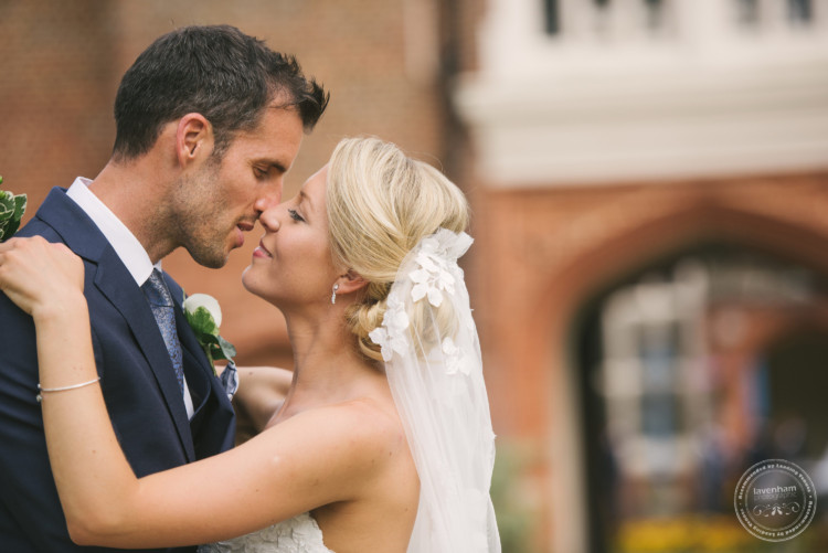 Tender moment between newlyweds. Relaxed wedding photography at Gosfield Hall