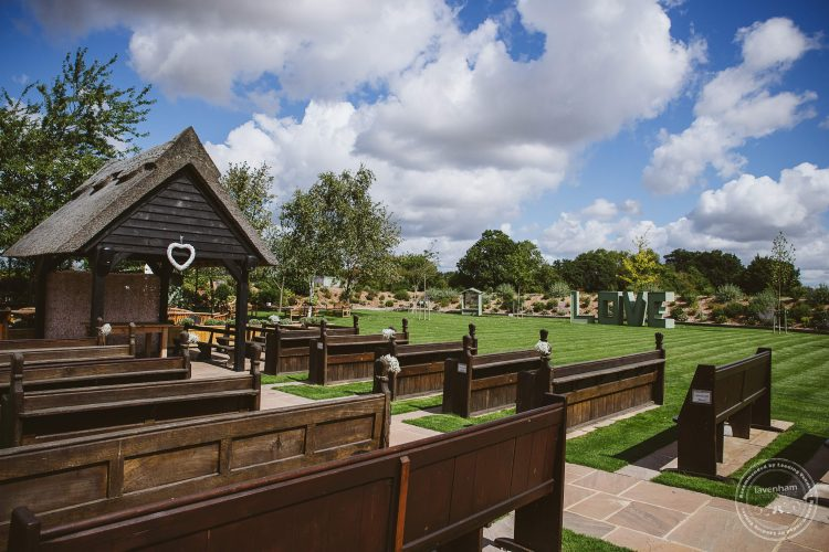 Channels outdoor ceremony area, showing lawns behind ready for the wedding