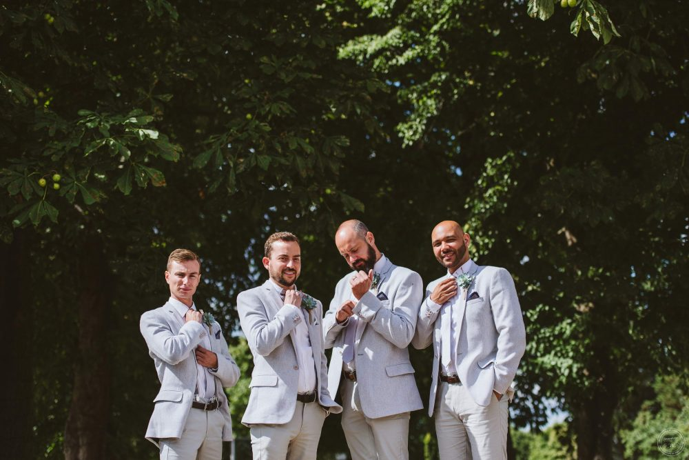 The groom with his groomsmen photographed before the wedding ceremony