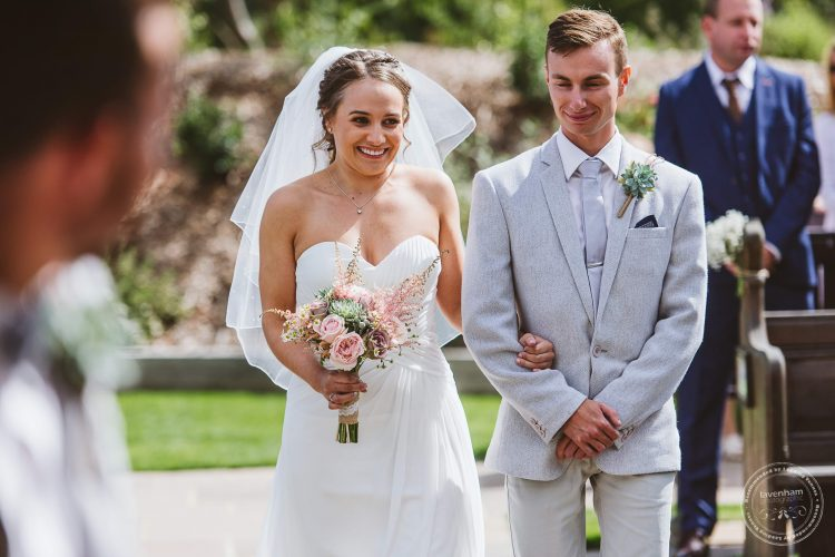 The bride walks down the aisle for her wedding ceremony at Channels