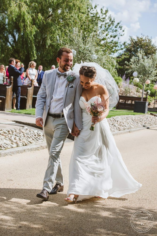 Bride and Groom, just married walk together