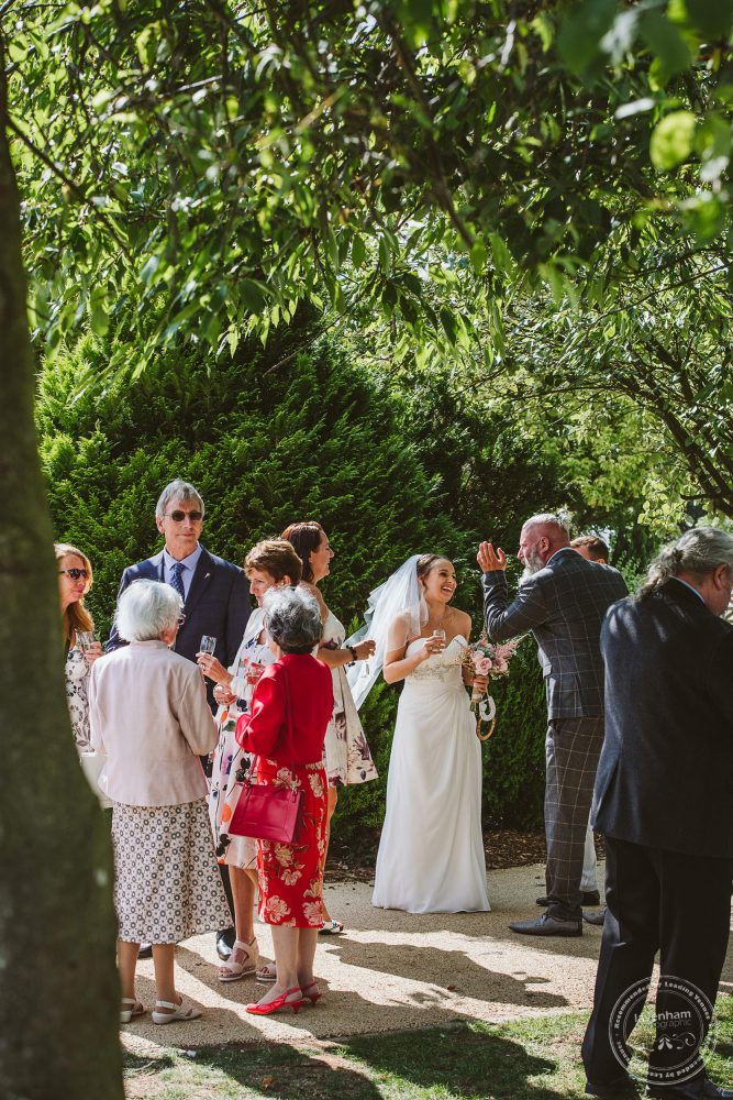 Guests chat over welcome drinks and canapes