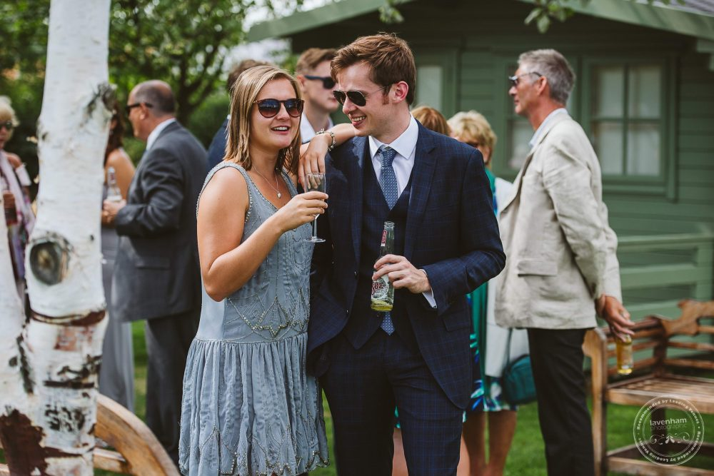 Casual Photography of wedding guests. A couple chat at Channels wedding