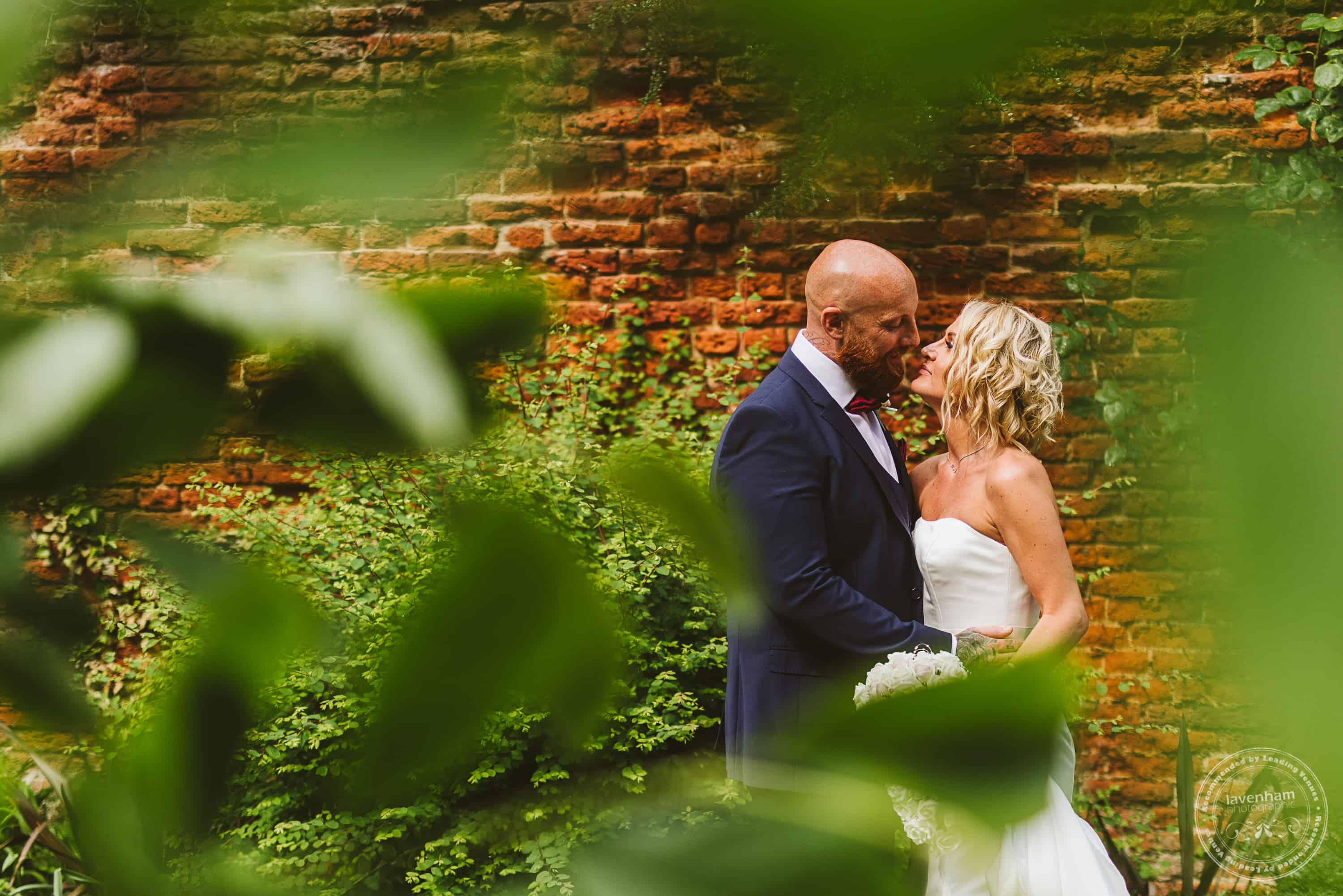 Framing a wedding photo through leaves