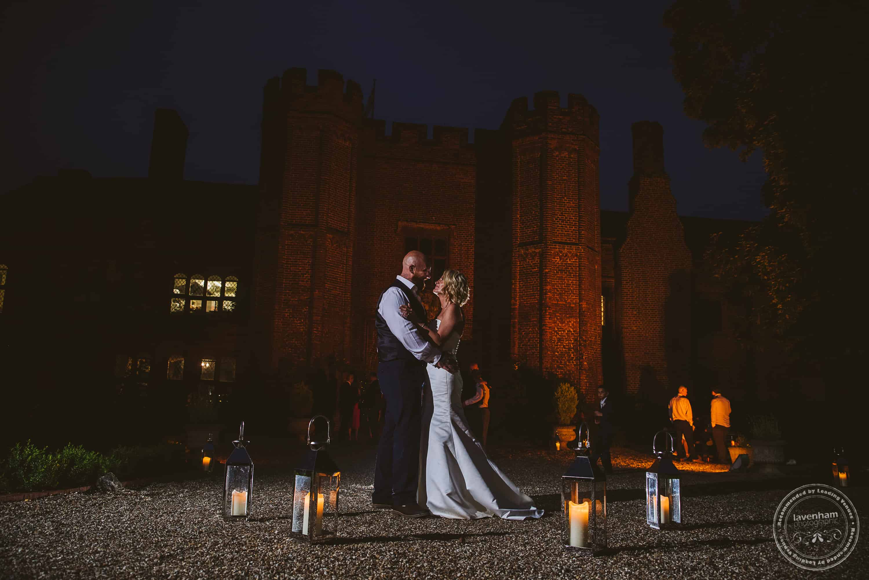A night time photo at Leez Priory with candles and floodlights