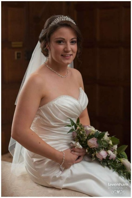 Portrait of the bride sitting, in the bridal suite at Hengrave Hall