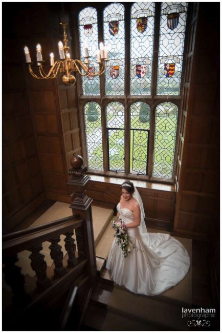 The bride on the staircase with huge window behind